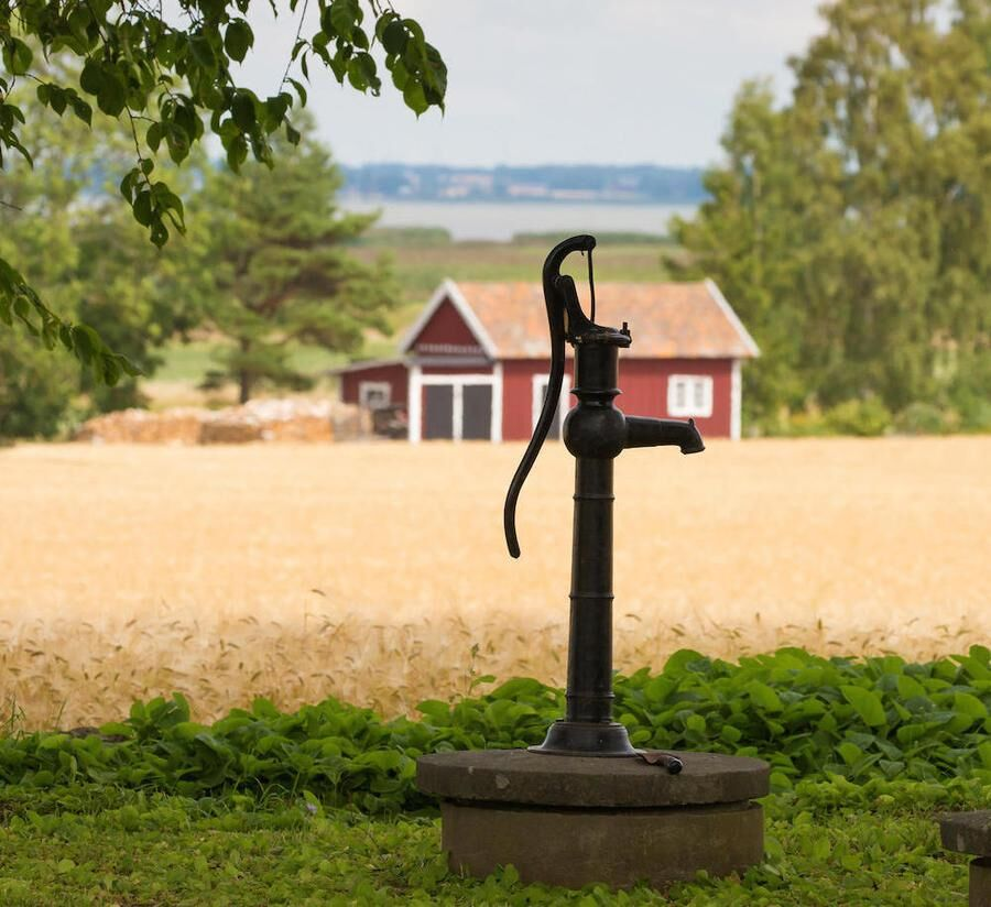 VADSTENA SWEDEN 26 July 2016. A typical old water pump on the country which probably is not used anymore,