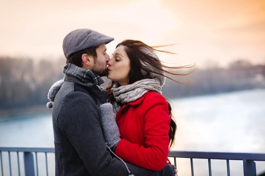 Winter couple kissing