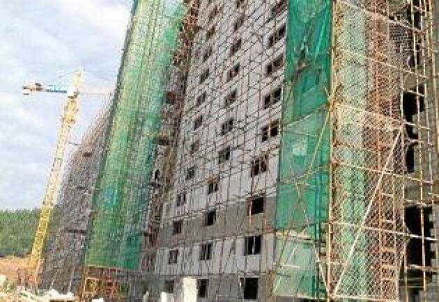 Foto: Skiold A/S Ett niovåningshus grisstall under uppförande i Guangxiprovonsen i Kina.