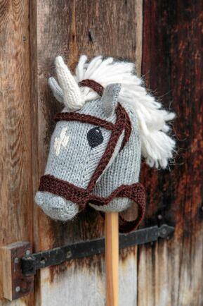 Enhörning med horn och fluffig man.