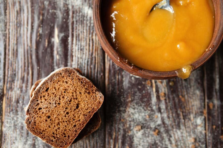 buckwheat honey in a bowl and pieces of rye bread, food