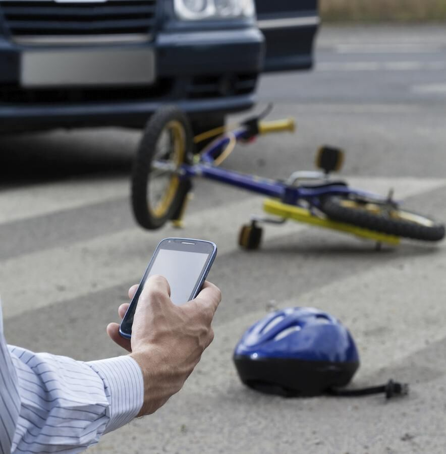 Man using his mobile phone to call for help on road